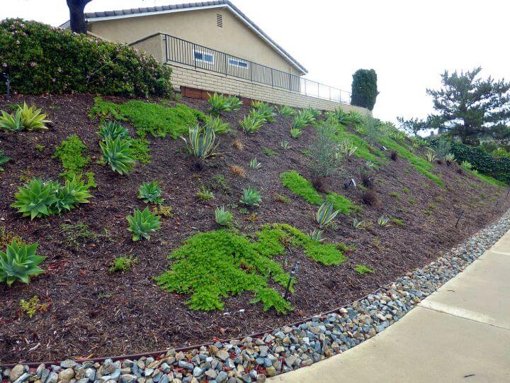 how to keep mulch on a slope